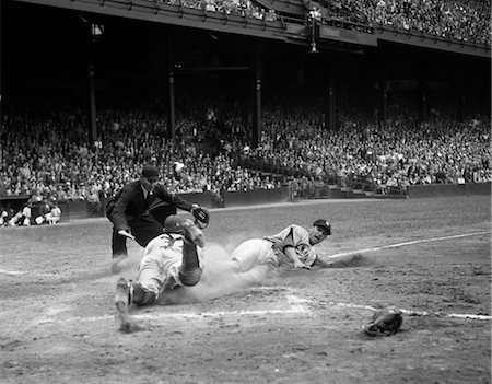 professional baseball game - 1950s PROFESSIONAL MAJOR LEAGUE BASEBALL GAME RUNNER SLIDING INTO HOME BASE AS UMPIRE SIGNALS SAFE Stock Photo - Rights-Managed, Code: 846-02792062