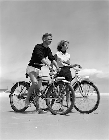 1950s TEENAGE BOY AND GIRL WITH BIKES ON THE BEACH Stock Photo - Rights-Managed, Code: 846-02792077
