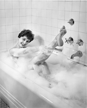 sexy women legs - 1950s SEXY SMILING WOMAN TAKING A SOAP SUDS BUBBLE BATH IN TUB LOOKING AT CAMERA Stock Photo - Rights-Managed, Code: 846-02792127