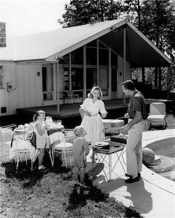 1950s FAMILY SERVING HAMBURGERS BESIDE POOL IN BACKYARD COOKOUT Stock Photo - Rights-Managed, Code: 846-02792186