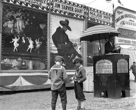 1920s BOYS COUNTING CHANGE FOR ENTRANCE TO CIRCUS SIDESHOW Stock Photo - Rights-Managed, Code: 846-02792227