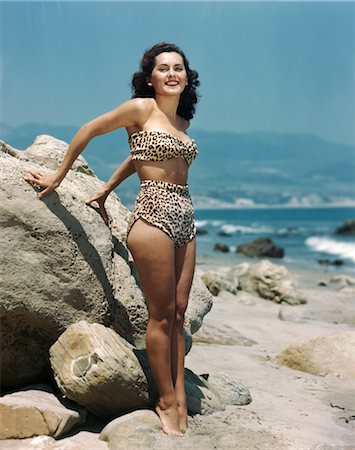 sandi model - 1940s BRUNETTE WOMAN LEOPARD SKIN TWO PIECE BATHING SUIT STANDING ON ROCKY BEACH Stock Photo - Rights-Managed, Code: 846-02792325