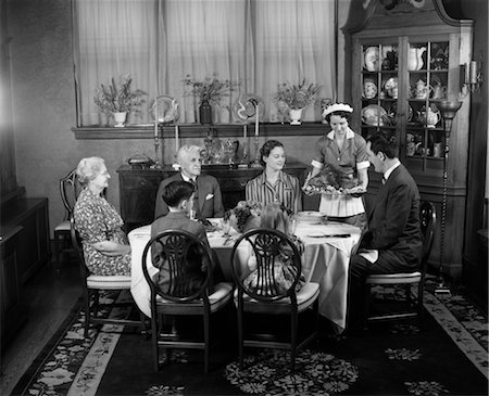 1940s TWO GENERATION FAMILY IN DINING ROOM THANKSGIVING TURKEY BEING SERVED BY MAID Stock Photo - Rights-Managed, Code: 846-02792346