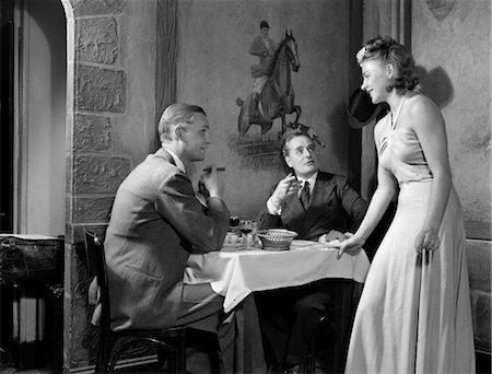 1930s 1940s 2 MEN EATING CLUB RESTAURANT 1 WOMAN FLIRTING TABLE BLOND WOMAN SMOKING CIGAR CIGARS Stock Photo - Rights-Managed, Code: 846-02792354