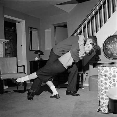 preteen girl boyfriends - 1960s TEENAGE COUPLE BOY & GIRL DANCING IN HOME LIVING ROOM DOING A BACKWARD DIP DANCE STEP Stock Photo - Rights-Managed, Code: 846-02792393