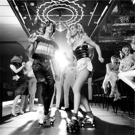 roller skate - 1970s COUPLE DISCO DANCING ON ROLLER SKATES WEARING TRENDY CLOTHES UNDER A MIRRORED BALL Stock Photo - Rights-Managed, Code: 846-02792443