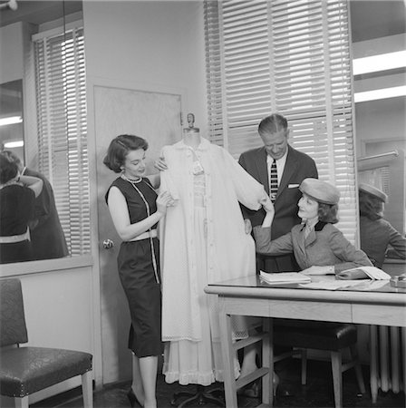 1950s FEMALE RETAIL FASHION BUYER SELECTING SAMPLE LINGERIE IN GARMENT INDUSTRY SHOWROOM Stock Photo - Rights-Managed, Code: 846-02792525