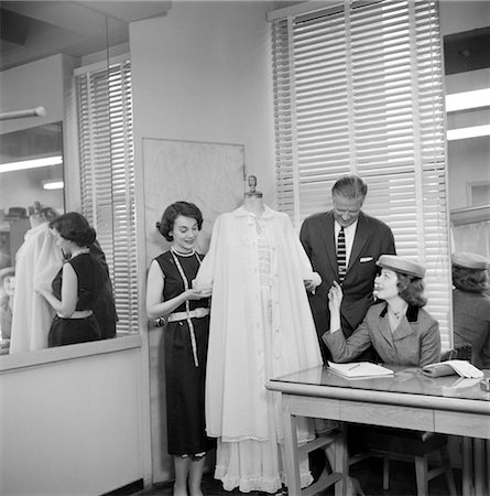 1950s FEMALE FASHION BUYER SELECTING LINGERIE CLOTHING IN A GARMENT INDUSTRY SHOWROOM Stock Photo - Rights-Managed, Code: 846-02792526