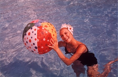 1960s WOMAN IN SWIMMING POOL HOLDING BEACH BALL Stock Photo - Rights-Managed, Code: 846-02792569