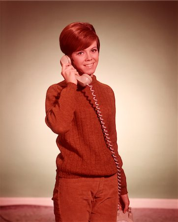 phone cord - 1960s WOMAN TALKING ON TELEPHONE LOOKING AT CAMERA Stock Photo - Rights-Managed, Code: 846-02792573