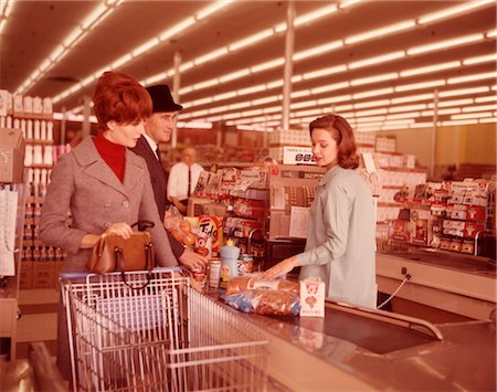 1960s COUPLE AT CHECK OUT COUNTER OF SUPERMARKET Stock Photo - Rights-Managed, Code: 846-02792592