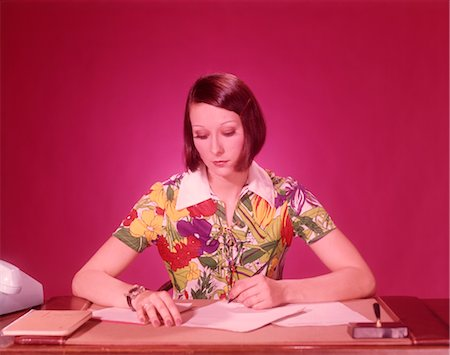 secretary desk - 1970s WOMAN AT DESK WEARING COLORFUL BLOUSE Stock Photo - Rights-Managed, Code: 846-02792658