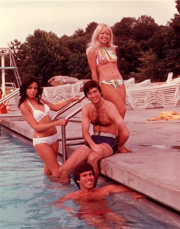 1960s 1970s GROUP OF YOUNG PEOPLE BY LADDER OF SWIMMING POOL Stock Photo - Rights-Managed, Code: 846-02792675