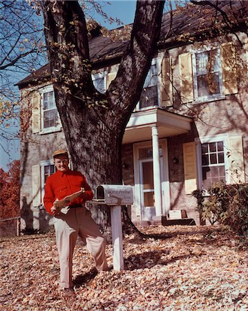 1950s ELDERLY MAN RED SHIRT GETTING MAIL IN FRONT OF STONE HOUSE AUTUMN Stock Photo - Rights-Managed, Code: 846-02792700