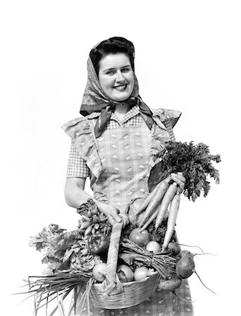 1940s WOMAN PORTRAIT AT CAMERA CARRYING BASKET FULL OF GARDEN VEGETABLES Stock Photo - Rights-Managed, Code: 846-02792946