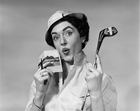 scoring - 1950s WOMAN HOLDING GOLF CLUB DRIVER AND SCORE CARD & PENCIL IN OTHER HAND PAR WORRIED EXPRESSION WEARING HAT AND CHECKED BLOUSE Stock Photo - Rights-Managed, Code: 846-02792992