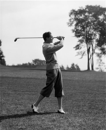 1930s GOLFER IN KNICKERS WITH CLUB IN AIR Stock Photo - Rights-Managed, Code: 846-02793015