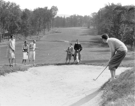 1930s MAN IN KNICKERS GOLFING IN SAND TRAP WITH MEN & WOMEN LOOKING ON Stock Photo - Rights-Managed, Code: 846-02793016