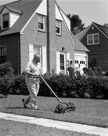 1940s 1950s ELDERLY OVERWEIGHT MAN PUSHING LAWN MOWER IN FRONT OF BRICK HOUSE Stock Photo - Rights-Managed, Code: 846-02793062