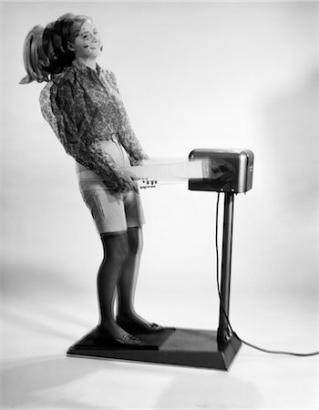 1960s WOMAN MASSAGED BY VIBRATING EXERCISE MACHINE Stock Photo - Rights-Managed, Code: 846-02793094