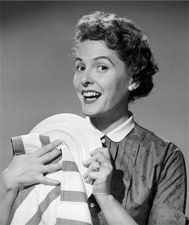 1950s WOMAN SMILING DRYING PLATE WITH STRIPE DISH TOWEL Stock Photo - Rights-Managed, Code: 846-02793137