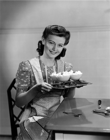photos of 1940s women in kitchen - 1940s WOMAN KITCHEN DESSERT SMILE APRON Stock Photo - Rights-Managed, Code: 846-02793131