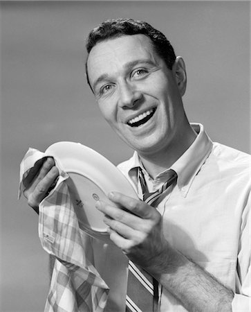 1950s SMILING MAN DRYING PLATE DISH Stock Photo - Rights-Managed, Code: 846-02793167