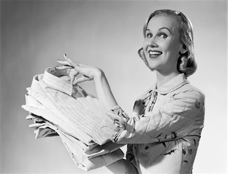 1950s PROUD SMILING WOMAN HOUSEWIFE HOLDING FRESHLY LAUNDERED MEN'S SHIRTS Stock Photo - Rights-Managed, Code: 846-02793194