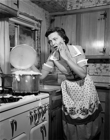 1950s HORRIFIED WOMAN HOUSEWIFE TAKING LID OFF COOKING POT BOILING OVER Stock Photo - Rights-Managed, Code: 846-02793191
