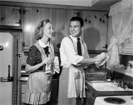 photos of 1940s women in kitchen - 1950s SMILING HAPPY COUPLE MAN AND WOMAN HUSBAND AND WIFE WASHING DRYING DISHES TOGETHER IN KITCHEN Stock Photo - Rights-Managed, Code: 846-02793201