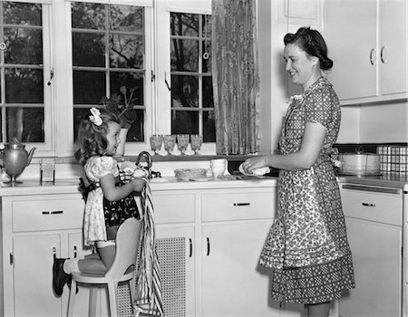 1930s 1940s WOMAN MOTHER WITH GIRL DAUGHTER KNEELING ON CHAIR HELPING WITH WASHING AND DRYING DISHES IN KITCHEN Stock Photo - Rights-Managed, Code: 846-02793240