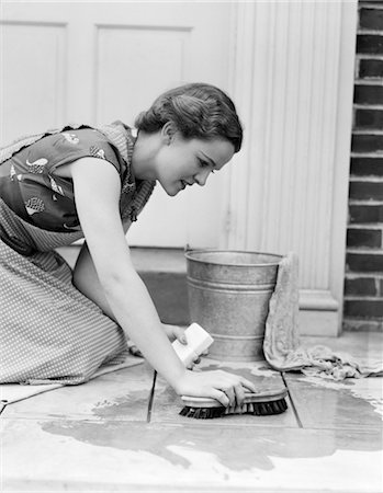 1930s 1940s WOMAN HOUSEWIFE KNEELING SCRUBBING DOORWAY FLOOR WITH BUCKET SOAP WATER AND BRUSH Stock Photo - Rights-Managed, Code: 846-02793257