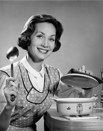 1960s WOMAN HOUSEWIFE ABOUT TO STIR POT WITH SPOON SMILING COOKING Stock Photo - Rights-Managed, Code: 846-02793269