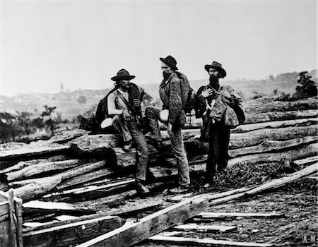 1860s CAPTURED MILITARY CONFEDERATE SOLDIERS SITTING PILE LOGS WOODEN RAILROAD TIES AMERICAN CIVIL WAR Stock Photo - Rights-Managed, Code: 846-02793309