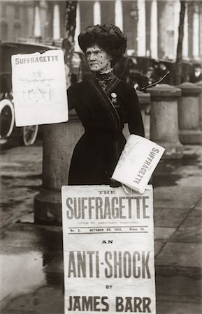 right - 1890s 1900s SUFFRAGETTE WOMAN DISTRIBUTING LITERATURE NEWSLETTER FLYER CITY STREET Stock Photo - Rights-Managed, Code: 846-02793322