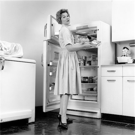 1950s WOMAN STANDING IN KITCHEN BY OPEN REFRIGERATOR Stock Photo - Rights-Managed, Code: 846-02793331