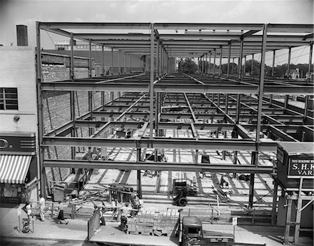 1950s COMMERCIAL SITE OF BUILDING CONSTRUCTION WITH STEEL GIRDER FRAME ERECTED MEN WORKING BELOW Stock Photo - Rights-Managed, Code: 846-02793360