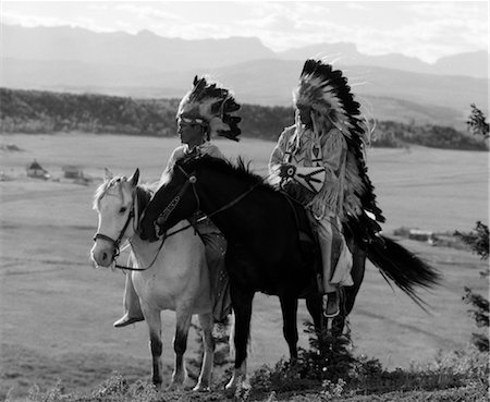 1930s PAIR OF SIOUX INDIANS WEARING HEADDRESSES ON HORSEBACK Stock Photo - Rights-Managed, Code: 846-02793447