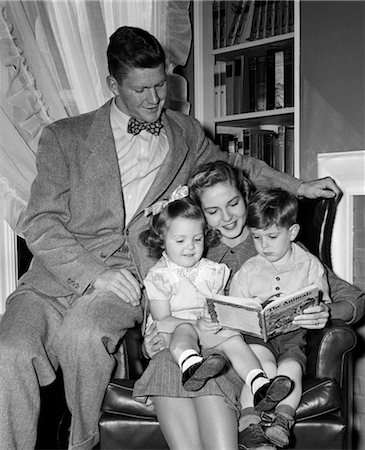 simsearch:846-02793283,k - 1940s WOMAN  MOTHER IN ARMCHAIR READING TO BOY SON GIRL DAUGHTER WITH PROUD MAN FATHER WATCHING Stock Photo - Rights-Managed, Code: 846-02793465