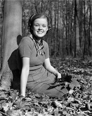 sitting under tree - 1940s PRETTY SMILING TEEN YOUNG WOMAN GIRL SITTING UNDER TREE IN AUTUMN LEAVES PORTRAIT Stock Photo - Rights-Managed, Code: 846-02793460