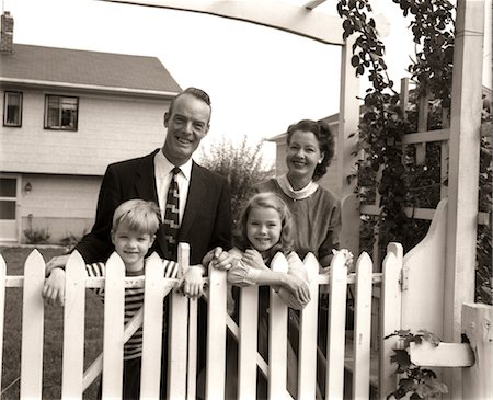 1950s FAMILY OF FOUR BEHIND PICKET FENCE IN BACKYARD SMILING AT CAMERA Stock Photo - Rights-Managed, Code: 846-02793536