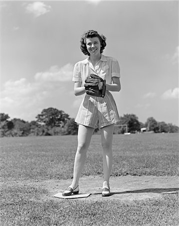 1940s SMILING TEEN GIRL WEARING SHORTS STANDING ON PITCHERS MOUND SOFT BALL GLOVE MITT ON HER HAND SOFTBALL Stock Photo - Rights-Managed, Code: 846-02793555