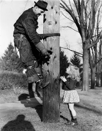 1930s-1940s LINESMAN RESCUING KITTEN FOR LITTLE GIRL Stock Photo - Rights-Managed, Code: 846-02793634