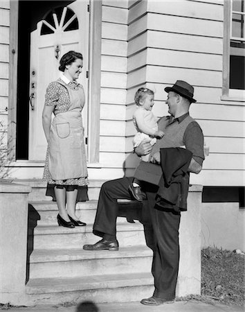 1940s FATHER ON STEPS HOLDING DAUGHTER WITH MOTHER WATCHING Stock Photo - Rights-Managed, Code: 846-02793676