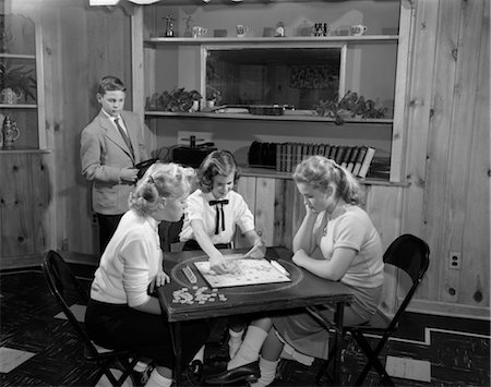simsearch:846-02793283,k - 1950s GIRLS PLAYING SCRABBLE IN REC ROOM WITH BOY CHANGING RECORDS Stock Photo - Rights-Managed, Code: 846-02793709