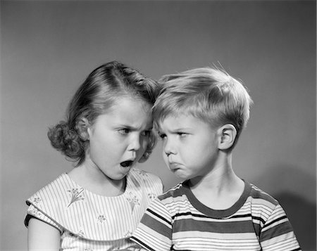 1950s BOY GIRL HEAD TO HEAD ANGRY FACIAL EXPRESSIONS ARGUMENT FIGHT Stock Photo - Rights-Managed, Code: 846-02793730