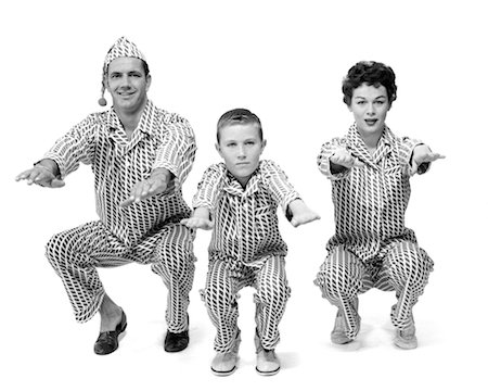 simsearch:846-02793283,k - 1950s FAMILY OF 3 IN PAJAMAS DOING KNEE BENDS FACING CAMERA Stock Photo - Rights-Managed, Code: 846-02793775