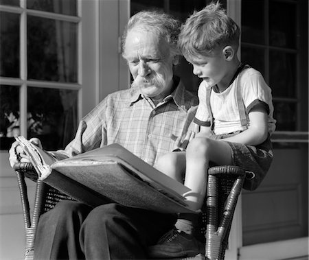 1940s GRANDFATHER ON PORCH READING TO GRANDSON Stock Photo - Rights-Managed, Code: 846-02793772