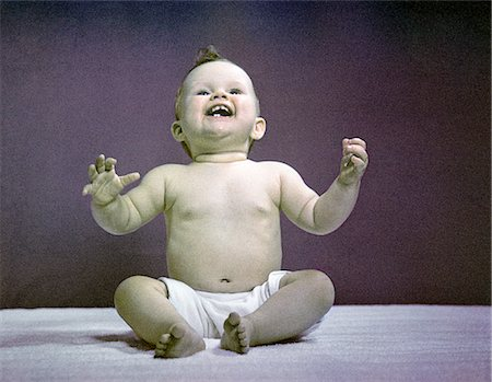 1940s 1950s FULL BODY SITTING BABY LAUGHING HANDS ARMS RAISED Stock Photo - Rights-Managed, Code: 846-02793972