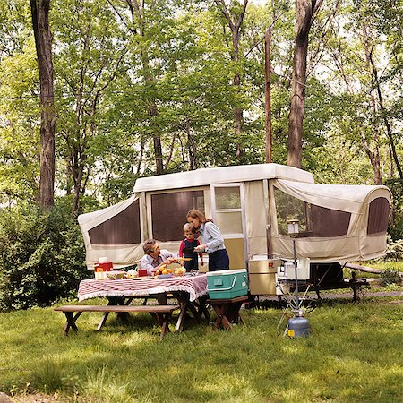 1970s FAMILY MOTHER FATHER SON CAMPING HAVING PICNIC BY CAMPER SUMMER VACATION Stock Photo - Rights-Managed, Code: 846-03164080